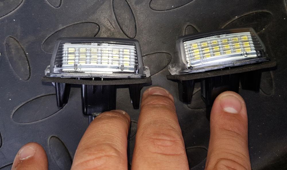 Как самостоятельно поменять лампы подсветки госномера на машине и что будет при её неисправности