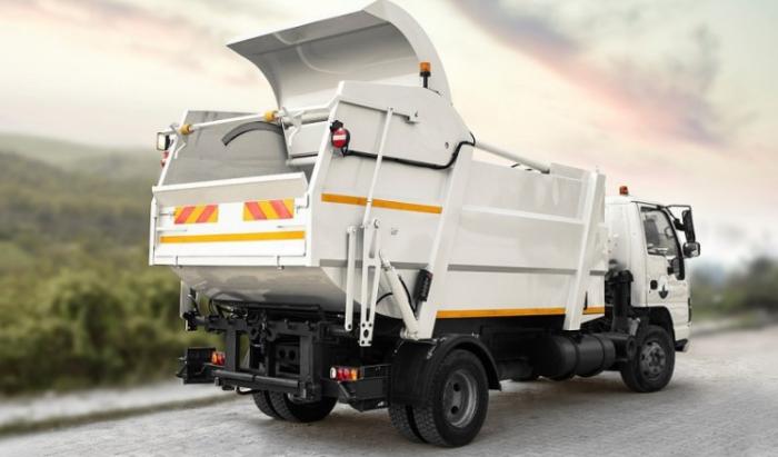 Современный мусоровоз HTM в работе